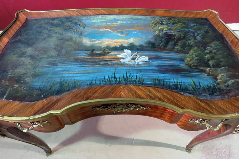 Regency style 1 drawer inlaid writing desk with a professionally hand-painted swan scene on a pond at night on a leather top and superb brass mounts. This desk was just professionally painted and shows no wear to the painted surface. It's a unique