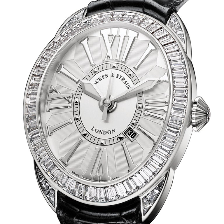 Regent Brexit 4047 is a luxury diamond watch for men crafted in white gold, featuring a white oval dial with white roman numerals, automatic movement. The case and crown are set with white baguette and Ideal Cut diamonds. It is a 40 mm x 47 mm