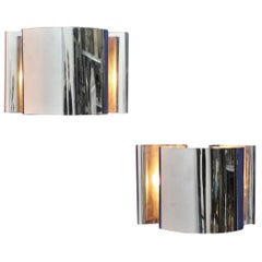 Reggiani Mid-Century Stylish Curved Chromed Steel Sconces, 1970s, Italy