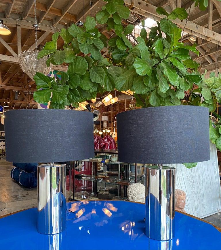 Reggiani, pair of Italian table lamps in chrome. Shades in black linen Measures: Base diameter 6