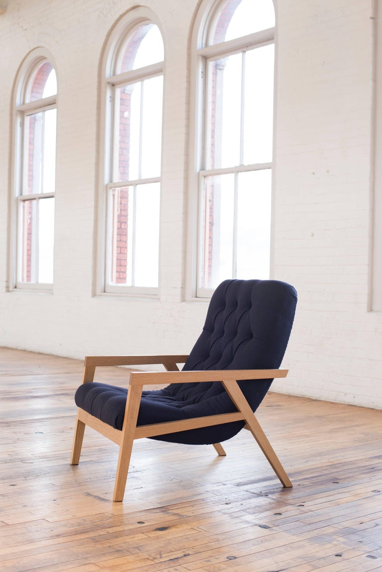 Phloem Studio Regina lounge chair, modern contemporary lounge chair with a exposed white oak frame and a comfortable wool fabric diamond tufted upholstery. A modern solid wood frame cradles a simple comfortable wool upholstered shell with