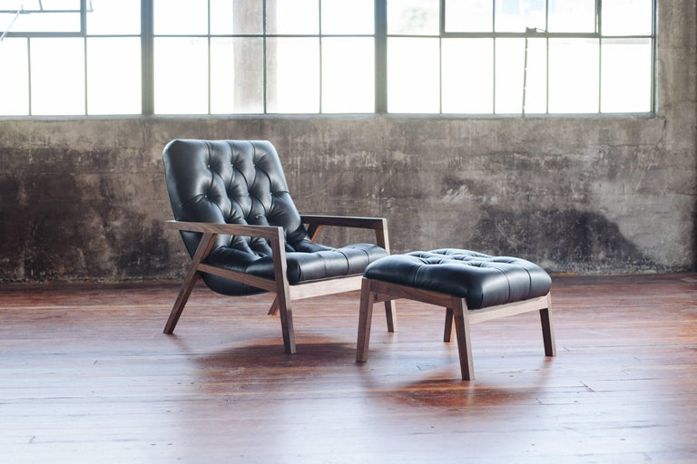Phloem Studio Regina lounge chair is a modern contemporary lounge chair with a exposed walnut hardwood frame that cradles an upholstered shell, with leather diamond tufted upholstery. The frames are hand crafted in walnut, white oak, or black.