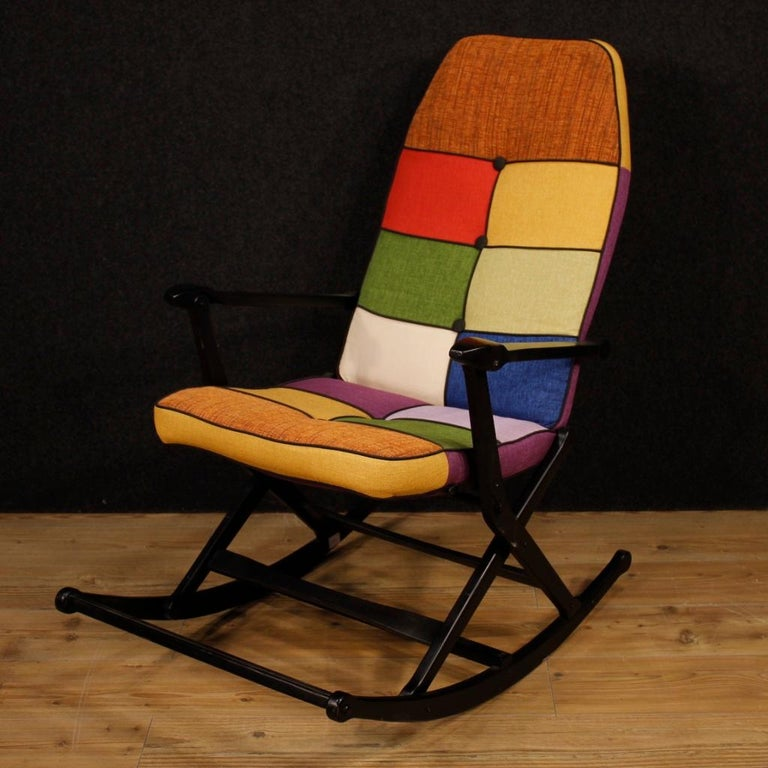 Italian rocking armchair from the 1960s. Lacquered wood furniture with fabric seat and back, not original, in perfect condition (just replaced). Reguitti design armchair, for interior designers and collectors. Foldable furniture to facilitate