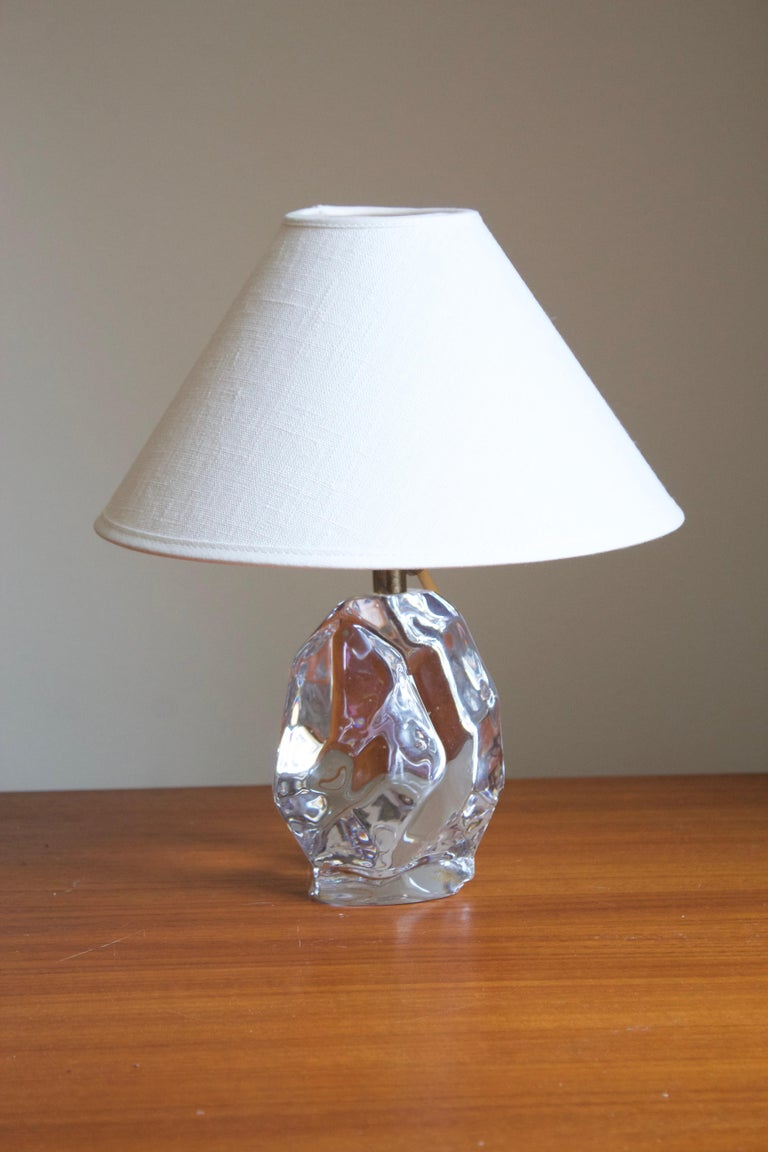 A modernist table lamp. Of Swedish production, produced by Reijmyre Glasbruk. In blown glass, 1950s.   Dimensions stated excludes lampshade. Upon request a lampshade of model illustrated can be included in the purchase.  Other designers of the