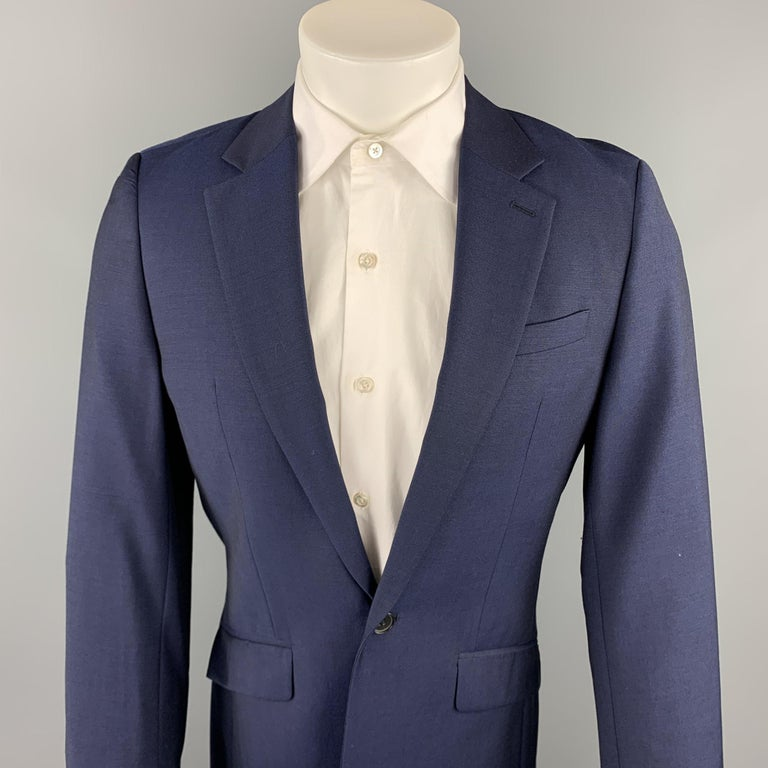 REISS suit comes in a navy wool with a full liner and includes a single breasted, single button sport coat with a notch lapel and matching flat front trousers.   Excellent Pre-Owned Condition. Marked: 36  Measurements:  -Jacket Shoulder: 17