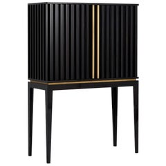Relevo Bar Cabinet in Ebony Makassar Structure and Antique Brass Handles