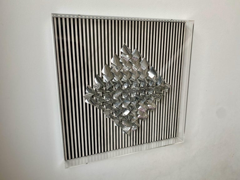 Mixed-media artwork  By Julio Le Parc  Aluminium relief on screen print  Plexi glass box  Signed, numbered and titled on the reverse  Denise René label  33 of 200  1970.