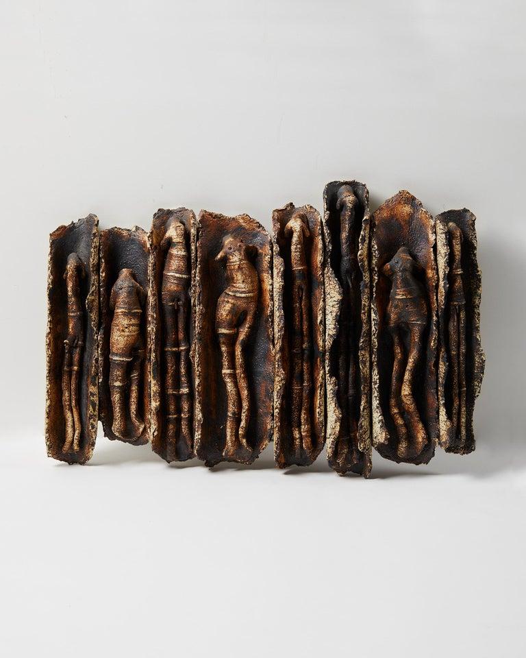 Stoneware, metal.  Measures: H: 38 cm/ 15