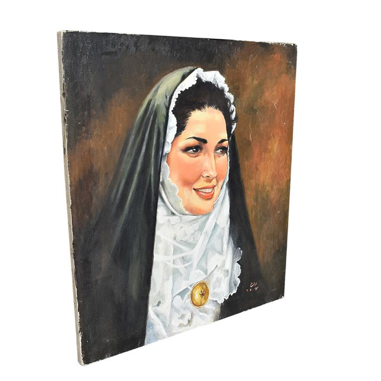 Oil on canvas portrait painting of a Catholic nun. This beautiful portrait of a woman is unframed and in wonderful vintage condition. The subject is of a Catholic sister, with black hair, dressed in her habit. A black veil with coif covers her head,
