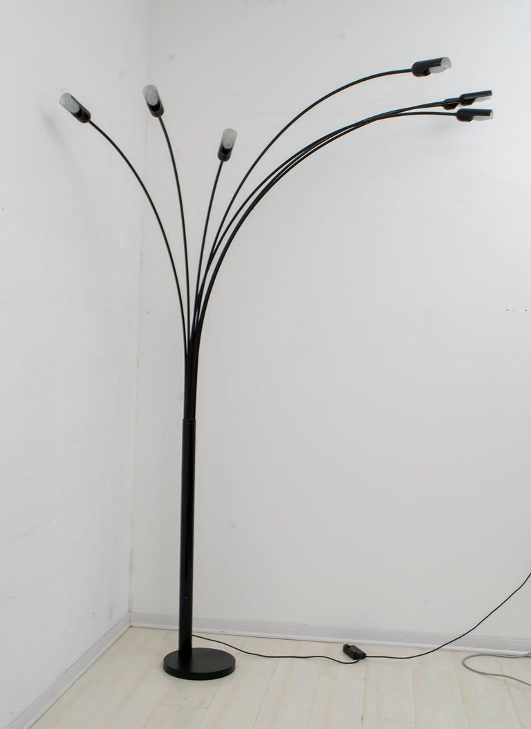 Floor lamp with seven arches of various sizes, produced in the 1970s by the Italian company Relux of Milan. The lamp has a dimmer to adjust the light density.