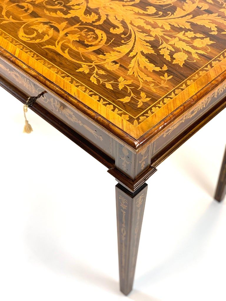 Extraordinarily detailed 19th century handcrafted writer's desk with exceptional floral marquetry inlay. Intricate tapering legs leading to the top with locking drawers and original key.
