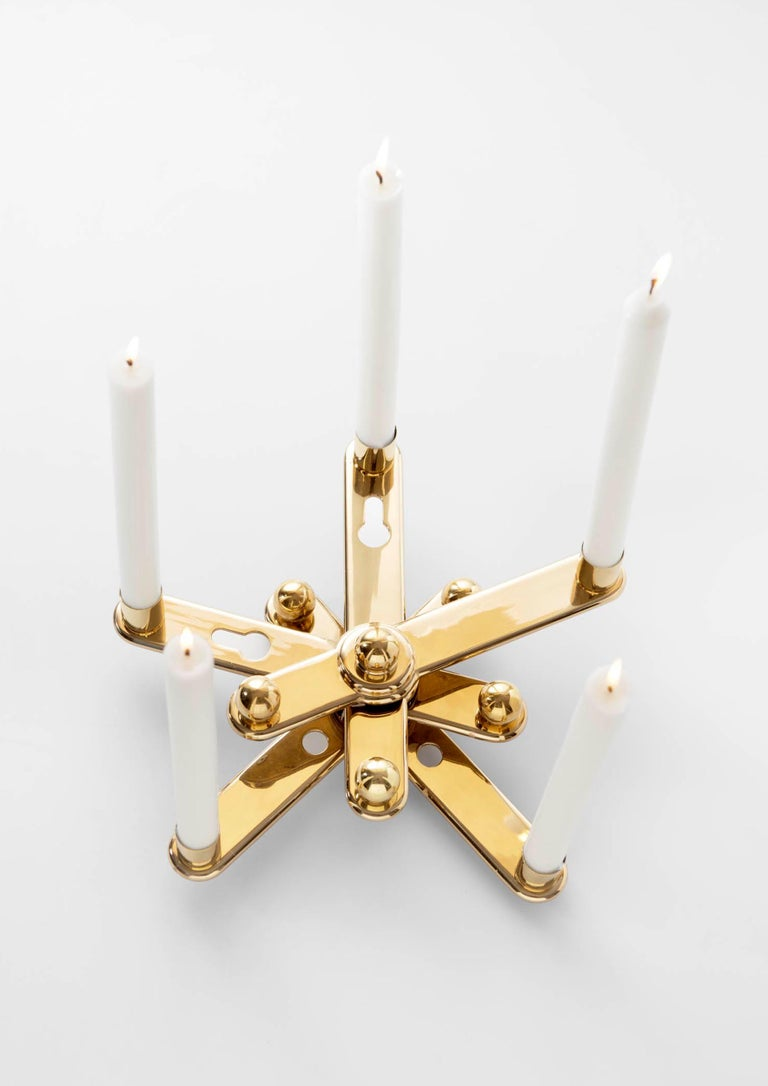Remix candleholders by Ramón Úbeda Limited edition of 75u Dimensions: 28 x 29 x 9 H cm Materials: Polished varnished brass   Curro Claret (Barcelona, 1968) studied Industrial Design in the Escuela Superior of Diseño Elisava and in Central Saint