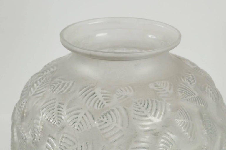 René Lalique vase Charmilles: 37 cm tall frosted glass monumental R. Lalique vase with an all-over decoration of leaf tips highlighted by remnants of patina Model: 978 created, circa 1926. Bibliographie: Félix Marcilhac, René Lalique, catalogue