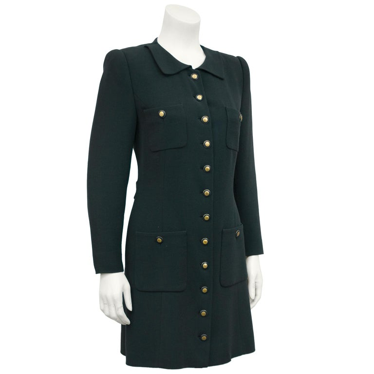 1990's Rena Lange forest green mini wool coat dress. Features four patch pockets and forest green and gold Rena Lange logo buttons. Half waist belt detail at back. Corresponding forest green Rena Lange logo lining. Excellent vintage condition.