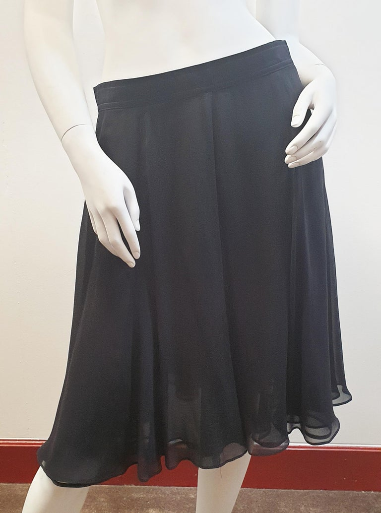 Rena Lange  Tulle and Viscose Black night skirt seemed to the waist with rayon  Size 40 Europe, Medium-Tall US Matching top also on sale  Rena Lange was founded in 1916 as a lingerie label M. Lange, and is ever since lead by the family Gunthert. In