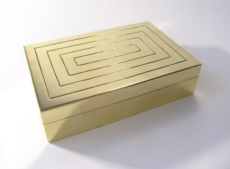 Gorgeous Art Deco engraved and polished brass jewelry box with wood lining. Handcrafted and signed by Austrian studio metalsmith J. Braun, with hammer logo. Stamped Rena, retailed at the original Rena Rosenthal store in New York City, circa