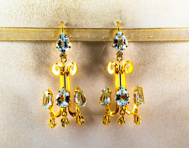 These Stud Earrings are made of 14K Yellow Gold. These Earrings have 0.16 Carats of White Modern Round Cut Diamonds. These Earrings have also 10.20 Carats of Aquamarines. These Earrings are available also with Emeralds. All our Earrings have pins