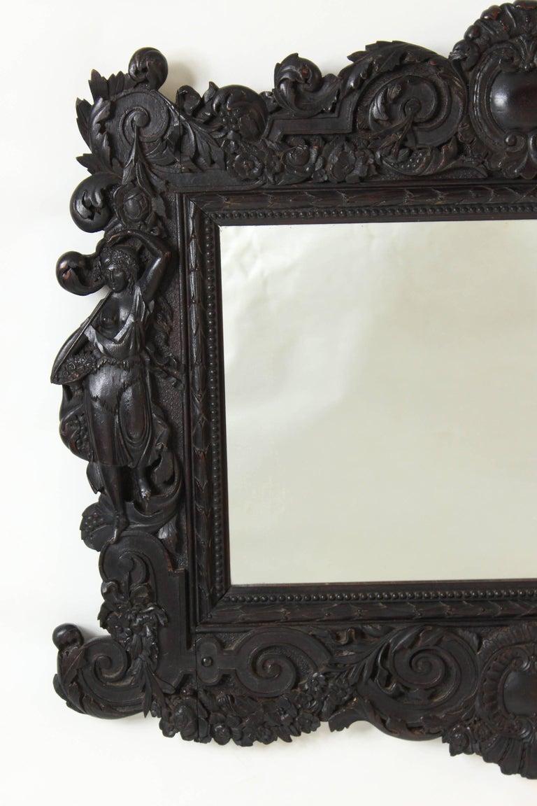 Renaissance Revival carved mahogany mirror, late 19th century.
