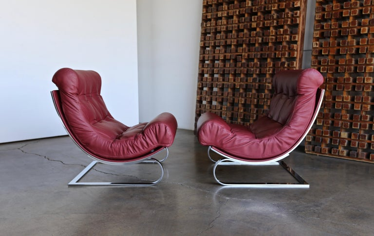 Renato Balestra leather lounge chairs for Cinova Italy circa 1970. This pair is in very good original condition. A really comfortable pair of chairs.