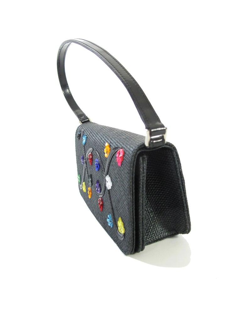 Vintage Renaud Pellegrino black raffia mini bag with jewel embellishments. Magnetic snap closure at front flap.   3.25