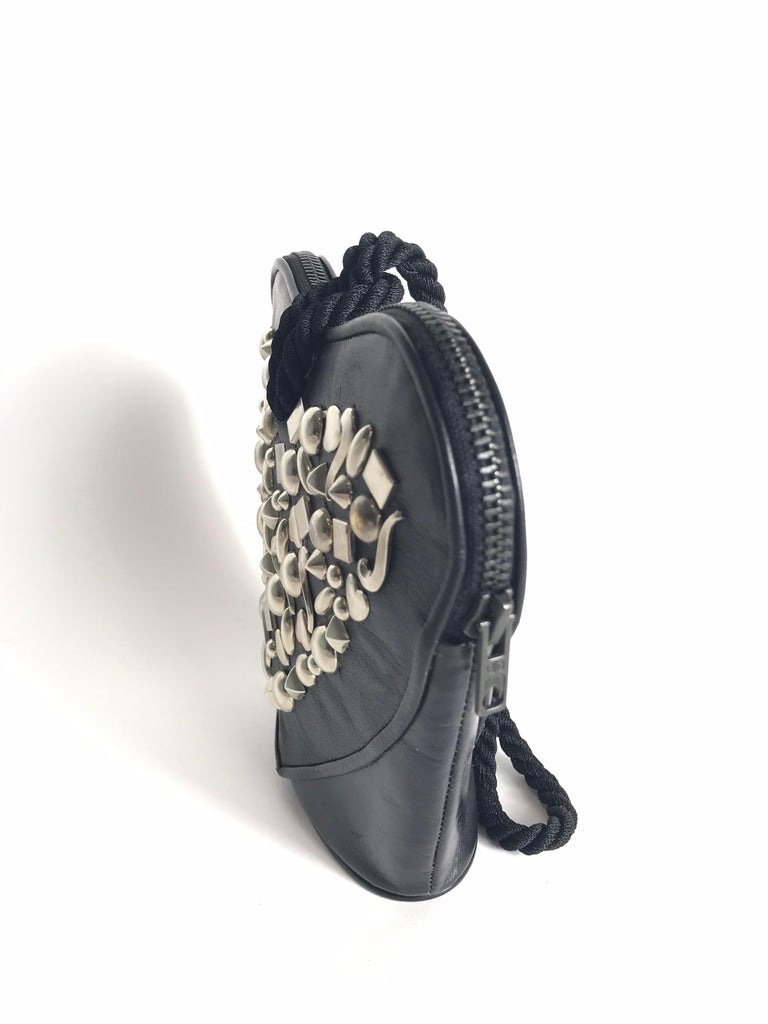 RENAUD PELLEGRINO black leather heart shaped studded small bag with cord strap. Condition: Excellent
