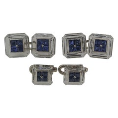René Boivin Carved Rock Crystal, Platinum and Sapphire Cufflink Set