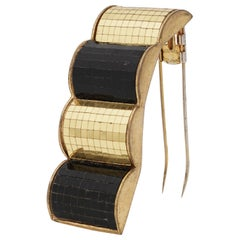 "René Boivin ""Les Irradiantes"", Gold and Black Mirrored Mosaic Brooch, circa 1930"