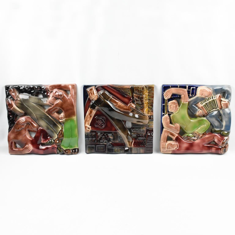 Stunning Rene Boschmans for Coceram cubist style figural ceramic plaque, wall tile depicting industrial, working, and sports scenes, set of three pieces. Cubist design on shiny glazed ceramic tile with industrial, and masonic symbolism.  The first