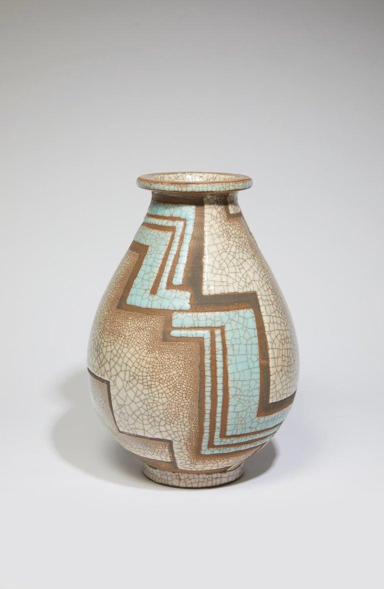 Ovoid vase in glazed ceramic cracked polychrome