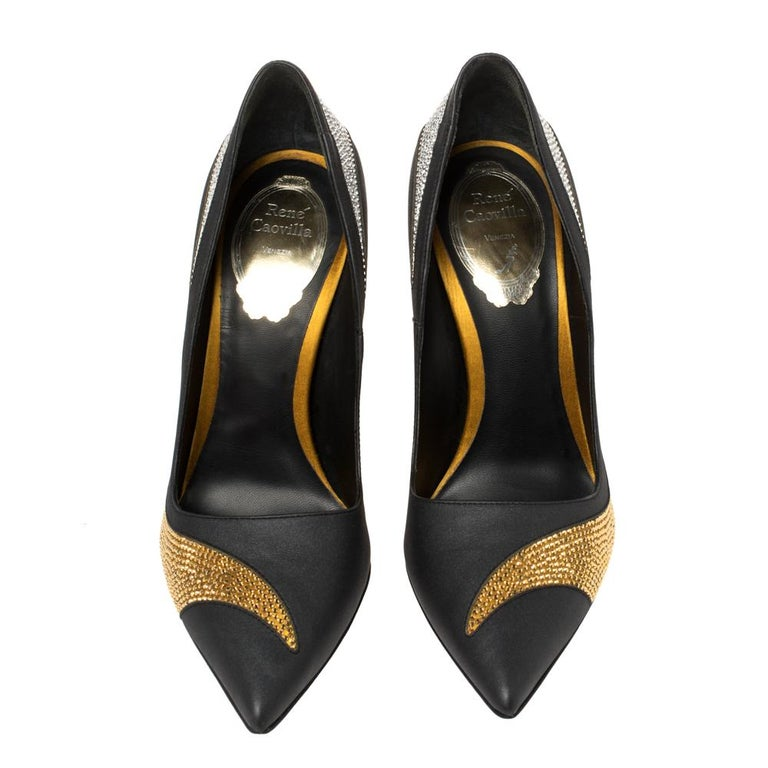 Walk with grace and confidence in these gorgeous pumps by René Caovilla. Styled in black satin and leather with dazzling crystal embellishments, pointed toes, and leather insoles to provide comfort, these pumps will never fail to lift your outfits.