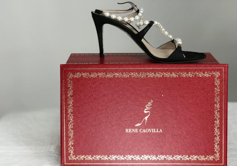 Rene Caovilla Black Wendy faux pearl and rhinestone, metallic suede ankle strap high heels, 36 1/2.  3 1/2 inch heels. With box and protector bags. They look barely, if ever worn. Gorgeous shoes.