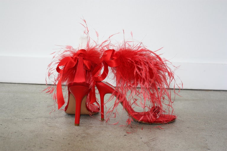 Rene Caovilla RED Satin and Feather Heels Size 37.5 Tonal rhinestone toe strap with feathers surrounding the ankle. Red satin ribbon back ankle tie. Minor wear to soles. SUPER GLAM !! Perfect for Holidays !! Size 37 1/2  Priced to sell quickly !