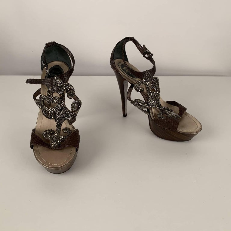 MATERIAL: Leather COLOR: Brown MODEL: Heeled Sandals GENDER: Women SIZE: 38 COUNTRY OF MANUFACTURE: Italy Condition CONDITION DETAILS: B :GOOD CONDITION - Some light wear of use - some rhinestones are missing, some wear of use on leather (on the