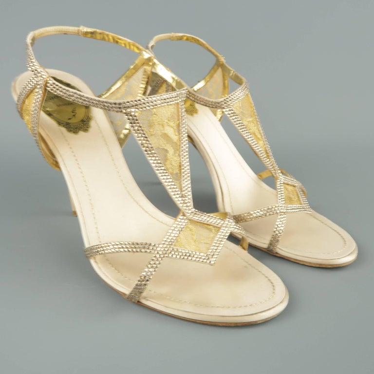 1369f4f3552 RENE CAOVILLA evening sandals come in a champagne silk satin and feature  geometric harness straps with