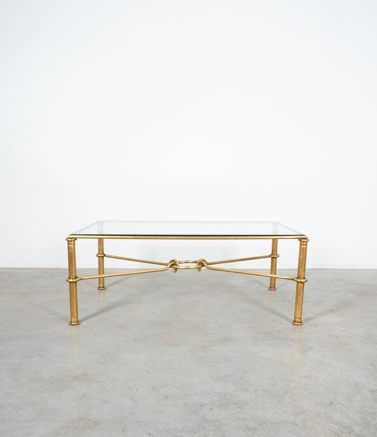 Very large gilt iron coffee table for Hermes by artist/designer Giovanni Banci, Italy, circa 1970  Large center coffee table neoclassical Hermes styling utilizing rings and hooks to simulate a horse bit. The thick high quality glass with smoothened
