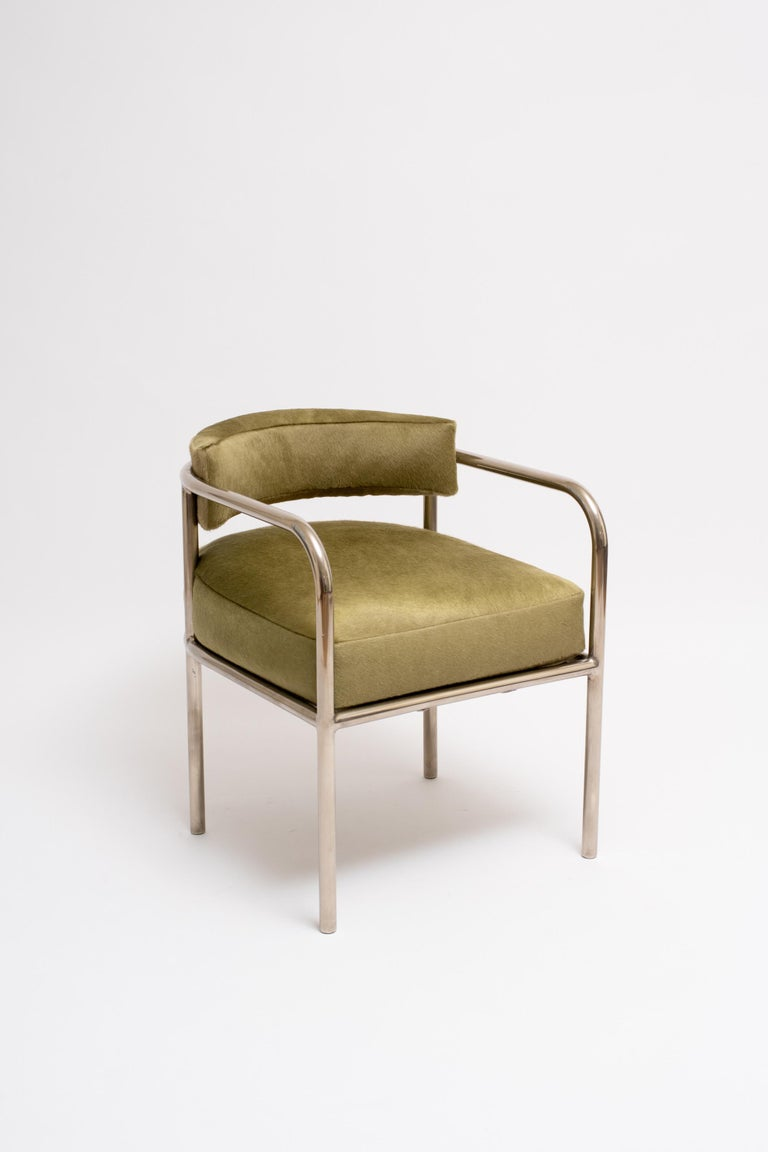 A rare armchair of nickel-plated tubular steel and calfskin cushions by French modernist René Herbst. Herbst was a founding member of the Union des Artistes Modernes, an influential group of progressive designers that included: Eileen Gray, Le