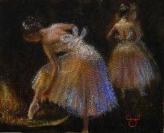 Ballet Dancer adjusting her Slipper