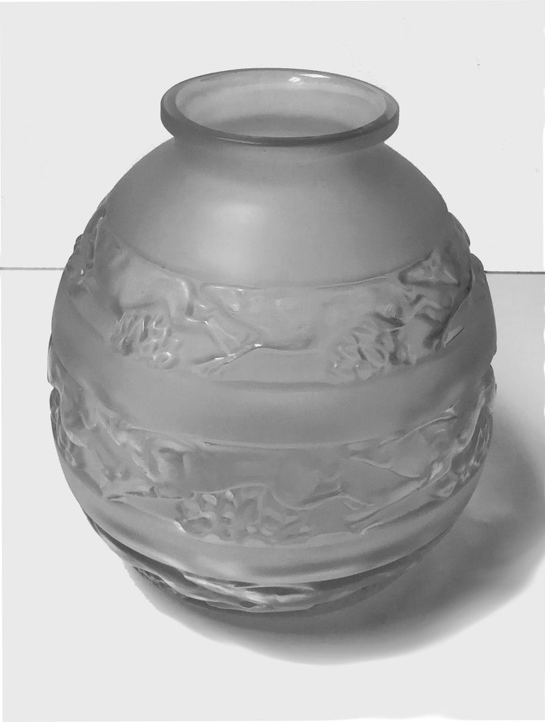 René Lalique (1860-1945) 1930s René Lalique signed vase. Pattern Soudan, three bands of gazelles mold blown clear frosted satin glass. Signed R. Lalique. Measures: Height 18.25cm. Condition: Good.