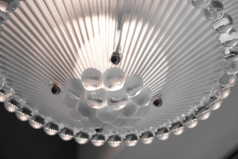 Rene Lalique chandelier Perles: 45 centimeters diameter at the widest part, with two hanging levels of glass and a matching large ceiling cap and cylindrical cover for the bar or rope holding the lower section with ribbed centre section to each