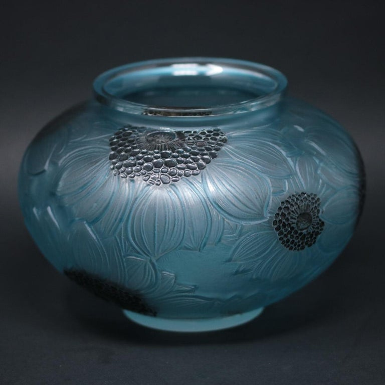 René Lalique clear and frosted glass 'Dahlia' vase. This pattern features overlapping Dahlia flowers, molded around the outside. Black enameled stamens and green/blue stained leaves. Moulded makers mark, 'R LALIQUE'. Book reference: Marcilhac 938.