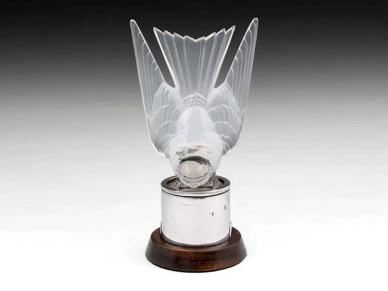 Rene Lalique Hirondelle (Swallow) model number #1143 with clear frosted finish. Markings on the base have been polished to accommodate the original chrome radiator mount complete with bulb and wires for illumination when attached to a car. 