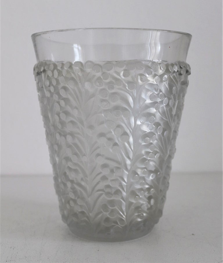 Gorgeous vase made of press-molded frosted and clear glass by René Lalique, France, design circa from 1937. The decoration of the glass consists of leaf tendrils and small berries, and goes up to approx. 1in (2.5cm) below the edge of the