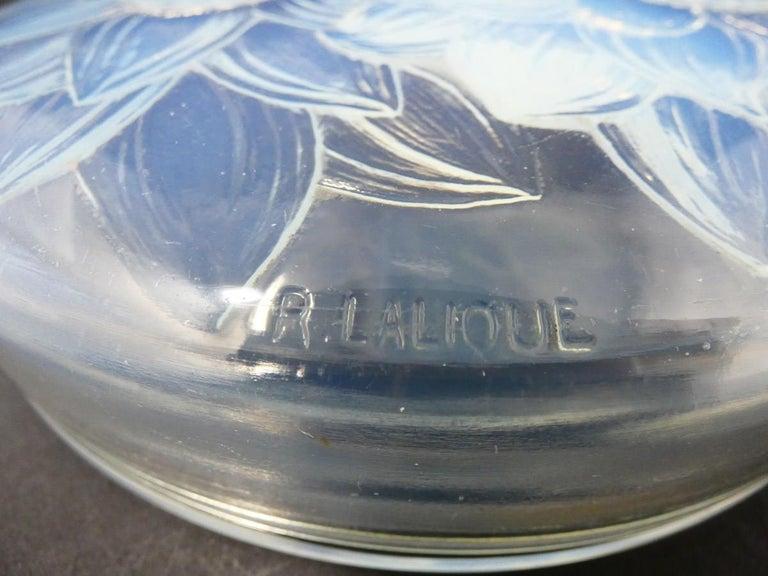 René Lalique opalescent glass 'Trois Dahlias' Box. This pattern features three dahlias. Moulded makers mark, 'R. Lalique '. Book reference: Marcilhac 46.
