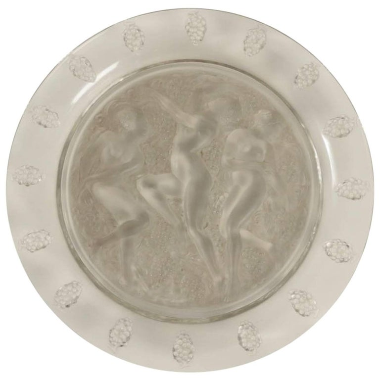 Plat Côte d' or 40 cm wide glass with elevated curved grapes decorated rim and frosted central section having three nude cavorting females amongst grapes; Clear round glass the elevated rim decorated with interspersed grapes which surrounds a