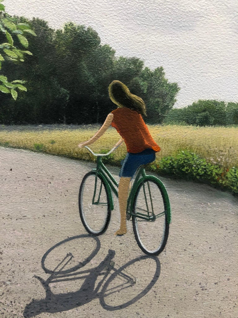 "Harvest, Female Figure Riding a Bicycle on a Country Road , Oil on Panel, Framed - Contemporary Painting by René Monzón Relova ""Pozas"""