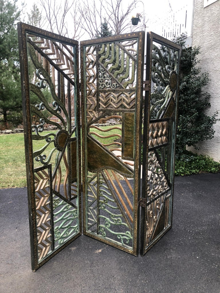 Room divider Art Deco screen Rene Paul Chambellan style mixed metal Three part folding screen of mixed materials bronze, gesso, painted, punch bronze metal work 72.5 tall 6 feet wide Three sections all original.