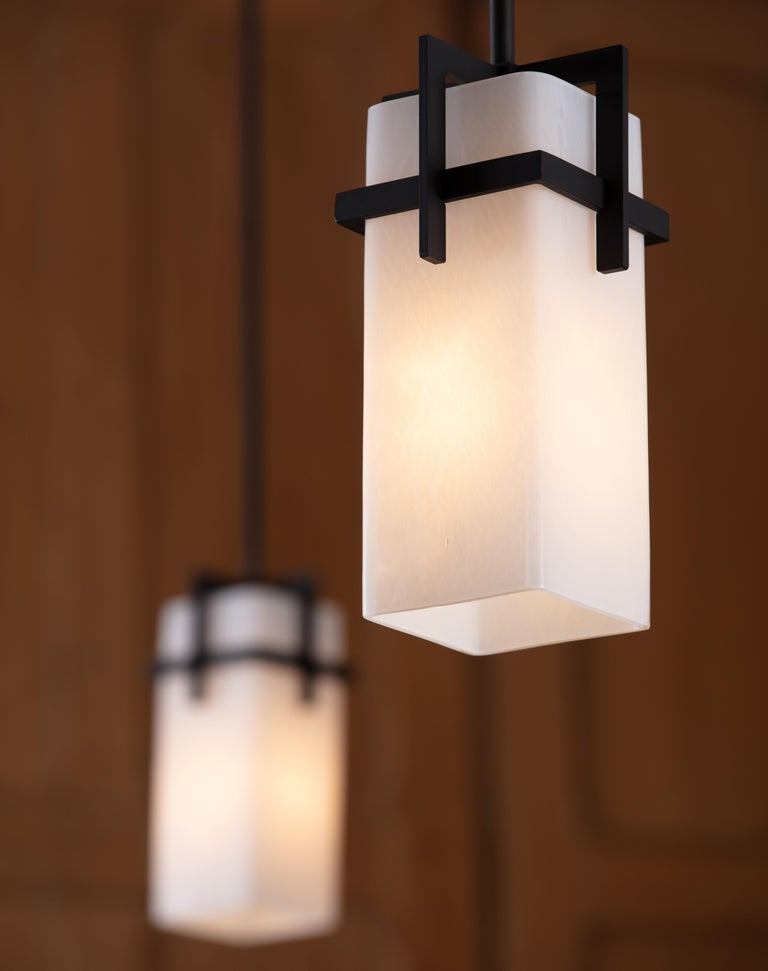 Mouth blown opaque glass with metal framing.  Bulb 1 x medium base 60 watt incandescent. 20lbs.  Measures: Overall height 71