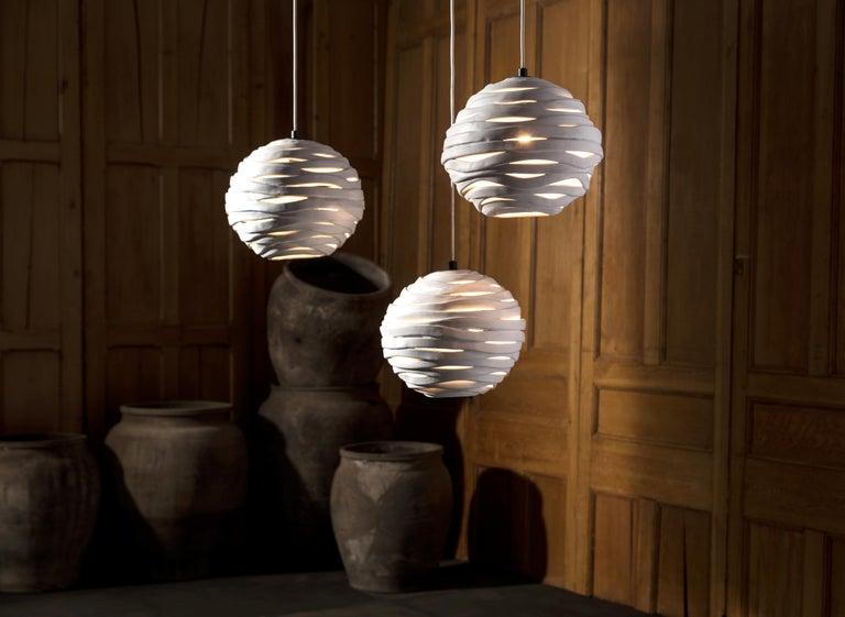 Reng, wrap, hand formed ceramic chandelier light.