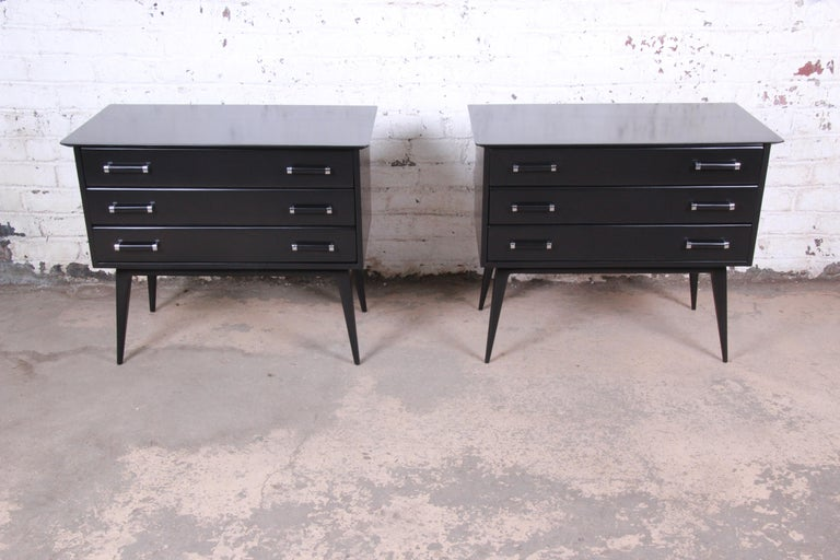 A rare and exceptional pair of Mid-Century Modern three-drawer bachelor chests or large bedside tables  Designed by Renzo Rutili for Johnson Furniture  USA, 1950s  Lacquered wood and chrome  Measures: 36