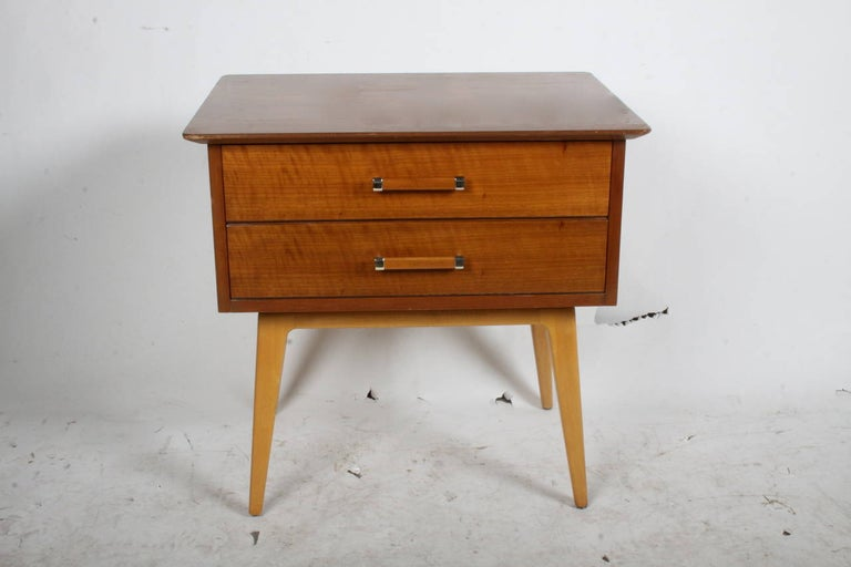 Two drawer Mid-Century Modern cherry nightstand, circa 1950s, designed by Renzo Rutili for Johnson Furniture Company. To be refinished prior to shipping, please allow several weeks.
